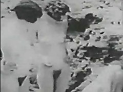 1928 vintage with a guy spying girls on the beach